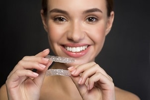 How to Avoid Demineralization While Using Invisalign